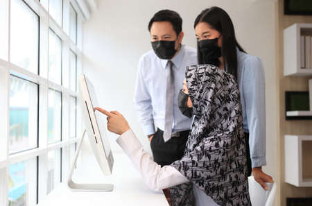 Asian Muslim female manager interviewing job applicant consulting male client at diverse group meeting negotiations, businesswoman  speaking to partner, human resource concept , business meeting Stockfoto