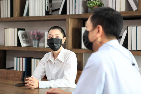 female and Businessman workers meeting together with wear protective masks prevent PM 2.5 and corona virus or covid19 at co working space .Health and teamwork concept