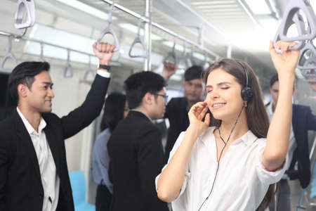 Passenger with casual suit  in the Skytrain rails or subway for travel in the big city, lifestyle and transportation concept