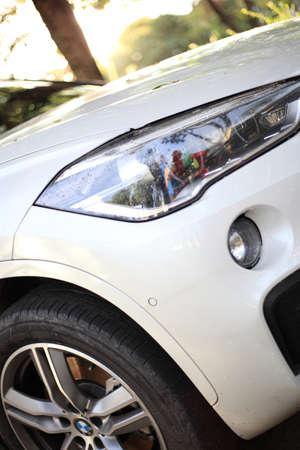 Close up front of new car parking , Modern car headlight close up photo Stockfoto