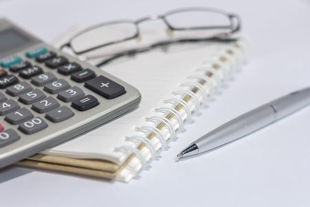 eyeglasses: eyeglasses and Calculator on book