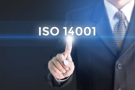A Businessman holding a white sign with the message ISO 14001. Can bring to the medium of your ad. Standard-Bild