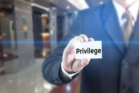 private club: Business man pressing hand Privilege word on virtual screen