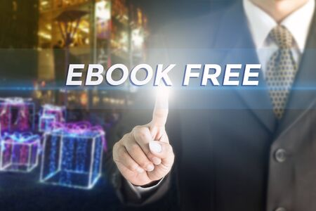 hidden costs: Business man pressing hand EBOOK FREE word on virtual screen. Stock Photo