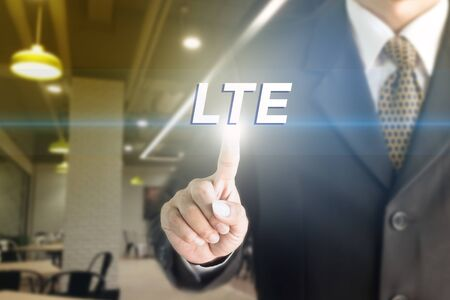 lte: A Businessman holding a white sign with the message LTE. Can bring to the medium of your ad. Stock Photo