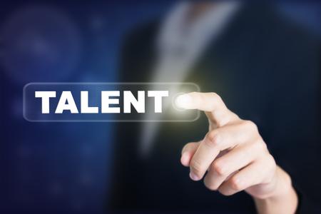 Empresario presionando un botón de concepto de talento. Puede ser utilizado en publicidad. Foto de archivo