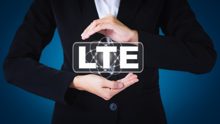 lte: Business women holding posts in LTE. Can be used in advertising.