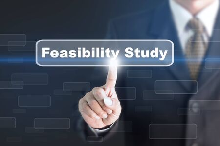 feasibility: Businessman pressing a Feasibility Study concept button. Can be used in advertising.