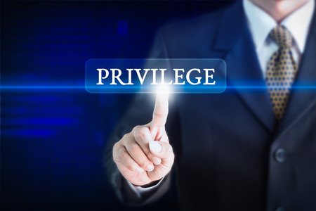 Businessman holding a white sign with the message PRIVILEGE. Can be used for your advertising.
