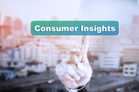 Businessman hand touch screen graph on Consumer Insights. Can be used for your ad.
