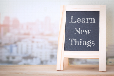 Concept Learn new things message on wood boards