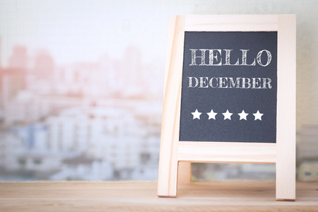 Concept HELLO DECEMBER message on wood boards