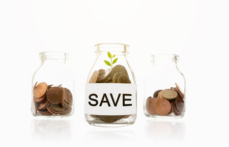 capital gains: save message on glass bottles, plant and coins, investment and business concepts