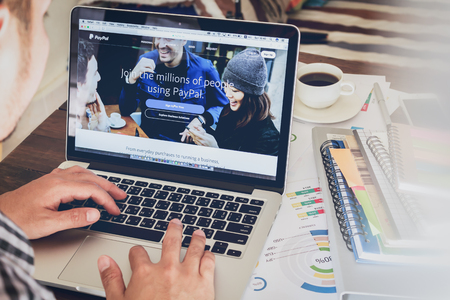 paypal: BANGKOK ,THAILAND - March 05, 2017 : Paypal web pages on laptop screen. is a popular and international method of money transfer via the Internet.