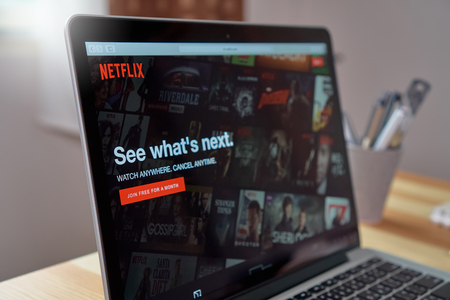 Bangkok, Thailand - August 23, 2017 : Netflix app on Laptop screen. Netflix is an international leading subscription service for watching TV episodes and movies.