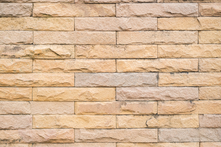Brick red background, stains on the wall The weather has long sun. Can be assembled in one part of advertising. Stock Photo
