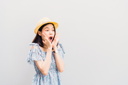 Young girl happy smile and cheerful in blue dress and lift hands on chin. Concept summer travel.