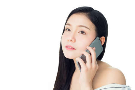 Close up portrait of woman talking smartphone. Concept of technology and skin care. on a white background Stock Photo