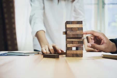women and teamwork making a pyramid with empty wooden cubes. Business concept with step-by-step for a firm basis.