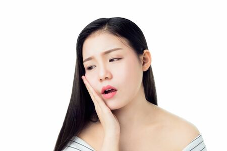 Asian girl in white casual dress Show off the toothache, Maybe because of not maintaining good oral health. on a white background gives a soft light. Banco de Imagens
