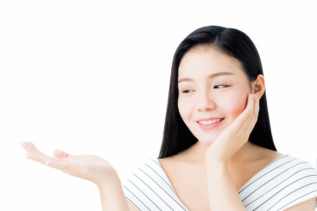 Portrait of woman is smiling skin beauty and health and lifting her hand as if holding a product on her hand, for spa products and make up. The skin is smooth and beautiful. concept of healthy women.