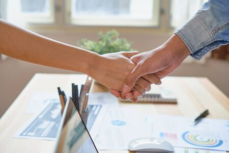 Joint Hands of Two Businessmen After Negotiating a Successful Business Agreement, And the handshake together. This is to promote cooperation in the joint business. Teamwork planning