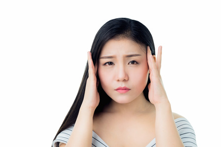 The woman is touching her head to show her headache. Causes may be caused by stress or migraine.