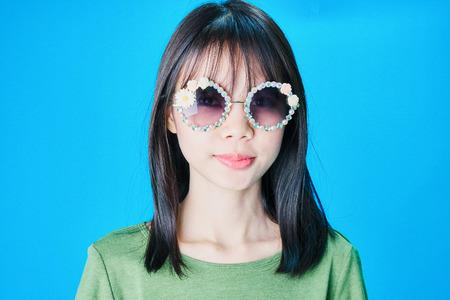 Women wear fashion glasses Showing happy gestures, Blue background.