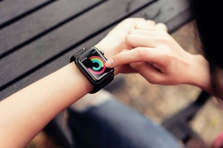 Bangkok, Thailand - April 02, 2018 : woman touch screen on checking activity app on Apple Watch, Created and developed by the Apple inc. Standard-Bild - 136695081