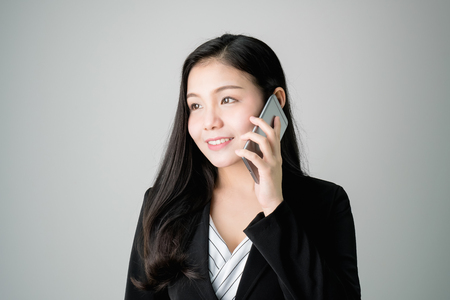 Business women are using the phone to discuss business deals. Concepts for digital technology in everyday Life. 版權商用圖片