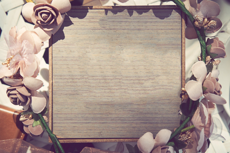 The Wooden board with beautiful flowers. vintage tone Stock Photo