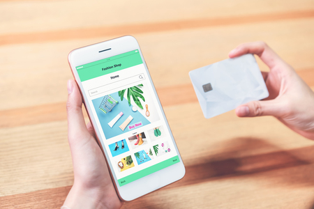 Women hold the smartphone and credit card shopping online store. The concept of providing marketing services on the internet for easy access to information.