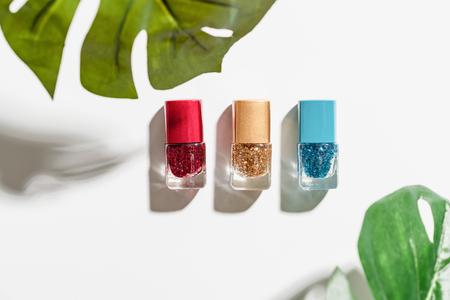Nail polish of beautiful colorful on white background.