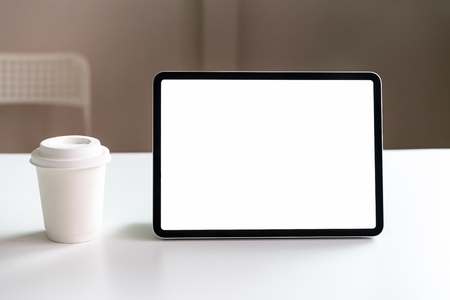 Tablet screen blank on the table mock up to promote your products. Concept of future and trend internet for easy access to information. Stock Photo