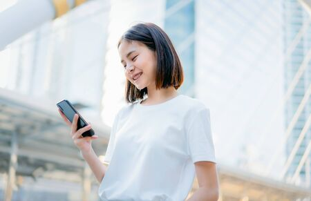 Asian women of happy smiling and using smartphone.The concept of using the phone is essential in everyday life. Reklamní fotografie