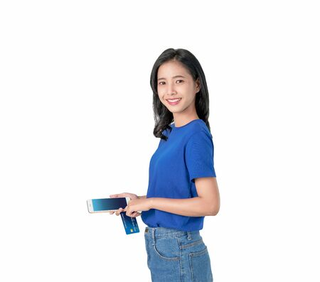 Asian woman good skin holding smartphone and credit card shopping online with bright smiling on white background. Standard-Bild - 130328030
