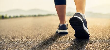 Runners' shoes are prepared to leave the starting point. Jogging workout and sport healthy lifestyle concept.
