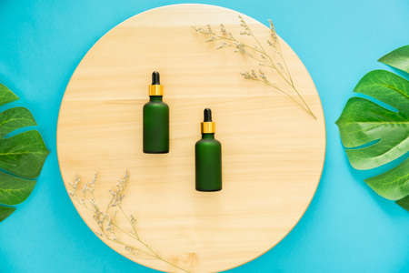 Green Medicine bottle, mockup of product brand. Top view on the blue background. Stock Photo
