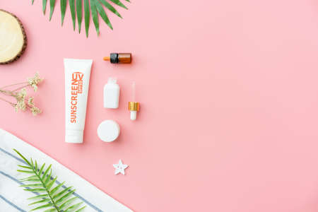 Sunscreen bottle cream, mockup of beauty product brand. Top view on the pink background. Stock Photo