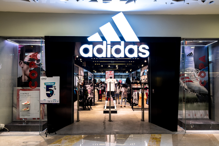 Jakarta, Indonesia - December 31, 2018: View of Adidas front store, a Germany multinational corporation that is engaged in the design, development, manufacturing, and worldwide marketing, in Jakarta.