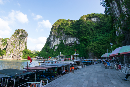 Quang Ninh, Vietnam, October 14, 2018:  View of Halong Bay Cruise ship parking at t Sung Sot Cave or Surprise Cave of Ha Long Bay, the wold heritage site in Vietnam.