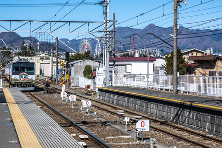Yamanashi, Japan - March 24, 2019 : View of Thomas land 20th anniversary train character coming in the morning at Mt. Fuji Station in Yamanashi, Japan. 新闻类图片