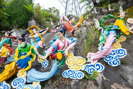 The iconic view of Statues of Fairies on clouds and pulling carriage with the Heavenly Chinese angel at Chin Swee Caves Temple, the Taoist temple in Genting Highlands, Pahang, Malaysia