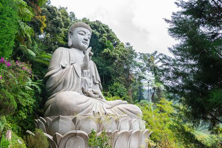 The iconic view of Large Stone Buddha Statue at Chin Swee Caves Temple, the Taoist temple in Genting Highlands, Pahang, Malaysia