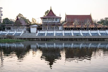 View of the old temple in the evening along with Khot river at Wat Tanod, Phra Nakhon Si Ayutthaya, Thailand