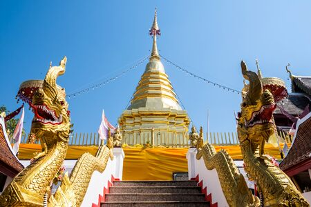 View of the golden pagoda at Wat Phra That Doi Kham temple in Chiangmai, Thailand. Reklamní fotografie