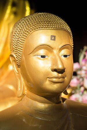 buddha statue: Face of golden buddha Stock Photo