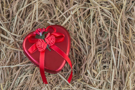 heart gift box: Heart gift box on hay background.