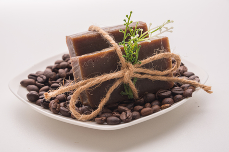 non  toxic: Traditional home made natural coffee soap with a pile of coffee beans on the background suggesting healthy organic non toxic wash products