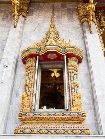 Buddha In Window Of Wat Hua Lamphong Temple Stock Photo - 17575057